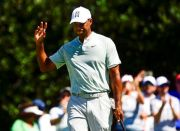 (AP Photo/John Amis). Tiger Woods acknowledges the gallery after making a birdie putt on the second green during the second round of the Tour Championship golf tournament Friday, Sept. 21, 2018, in Atlanta.