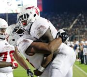 (AP Photo/John Raoux). Florida Atlantic running back Devin Singletary, right, gets a hug from offensive lineman Antonio Riles after he ran a 9-yard touchdown against Central Florida during the first half of an NCAA college football game, Friday, Sept. ...