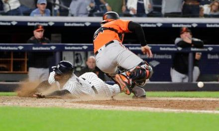 Yanks clinch wild card with 3-2, 11-inning win over Orioles