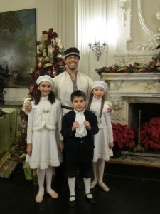 Caption: Glen Lewis with his students Malak Mohamed, Alexander Viveiros and Kathleen Medieros at Rosecliff ready to perform in Island Moving Co's Newport Nutcracker.  Island Moving Co photo.