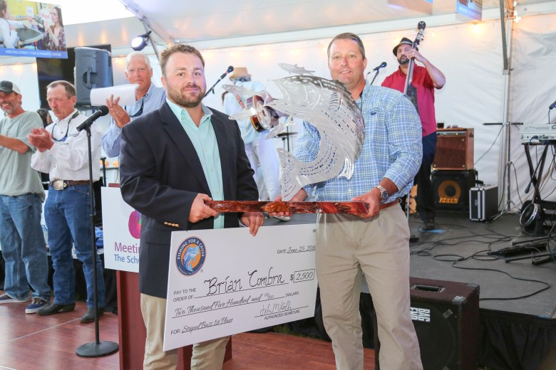 Brian Combra, of Newport, RI, took home the trophy for 1st place in the striped bass division in the 6th annual Fishing for a Cause event to benefit The Schwartz Center and Meeting Street. Combra donated his $2,500 winning check to Schwartz Center.