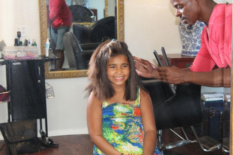 Amari Massey gets the glamour treatment from stylist Joel Taylor. PHOTO CREDIT: MLK Community Center