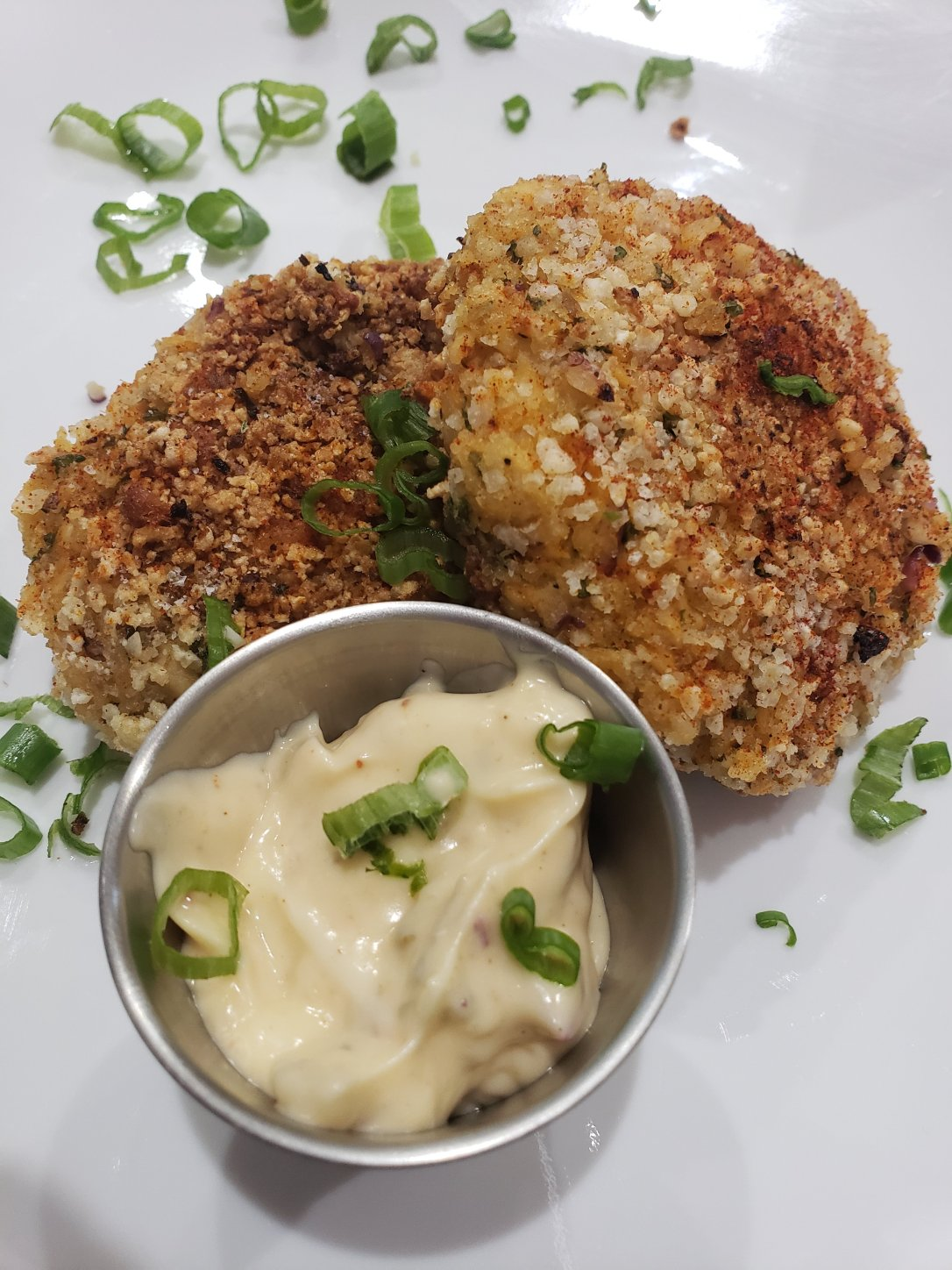 White plate salmon cakes and remolaude dipping sauce