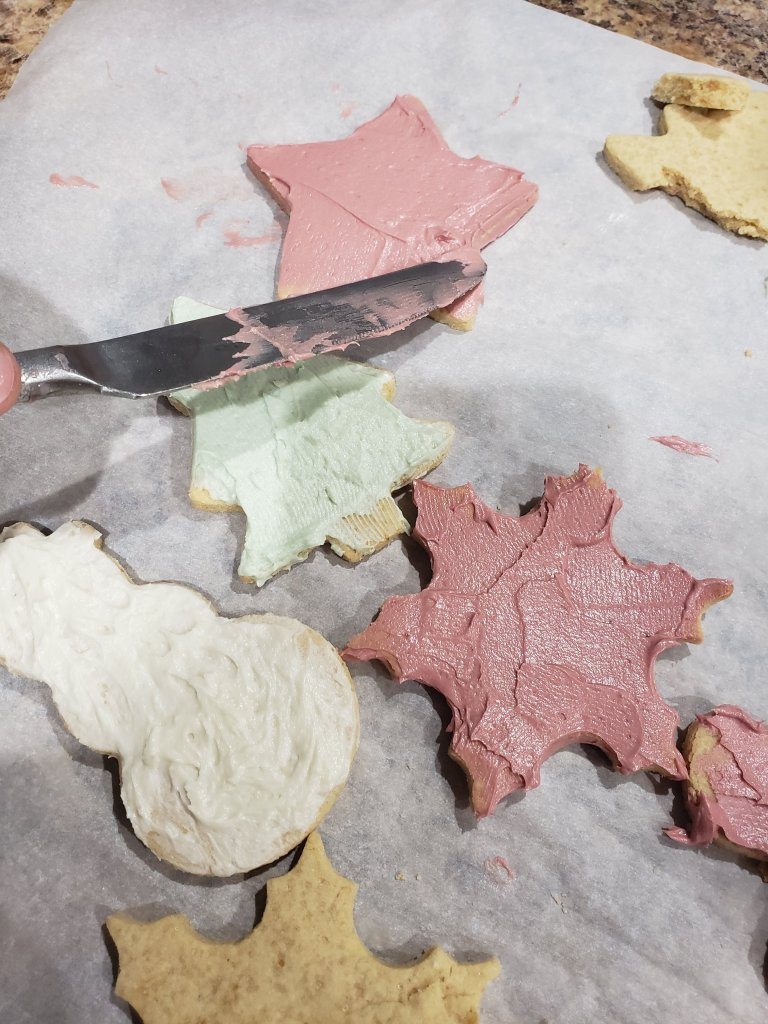 decorating cut out christmas cookies for santa