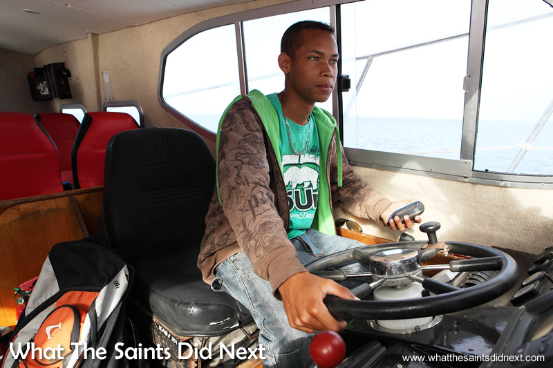 Alex at the wheel of the boat.