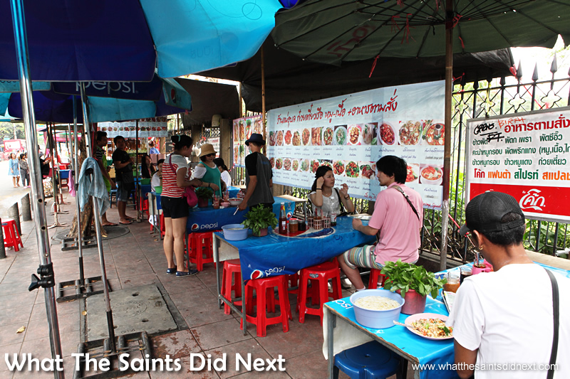 Chatuchak market food - a few chairs and tables on the pavement is all you need to make a restaurant.