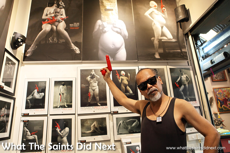 Thai photographer Wisamunmuang Sitthiket himself with his red gun art nudes.