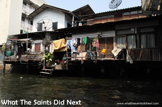 Satellite TV dishes are a constant feature throughout Bangkok, including on the canals. Bangkok Long Tail Boat Tour.
