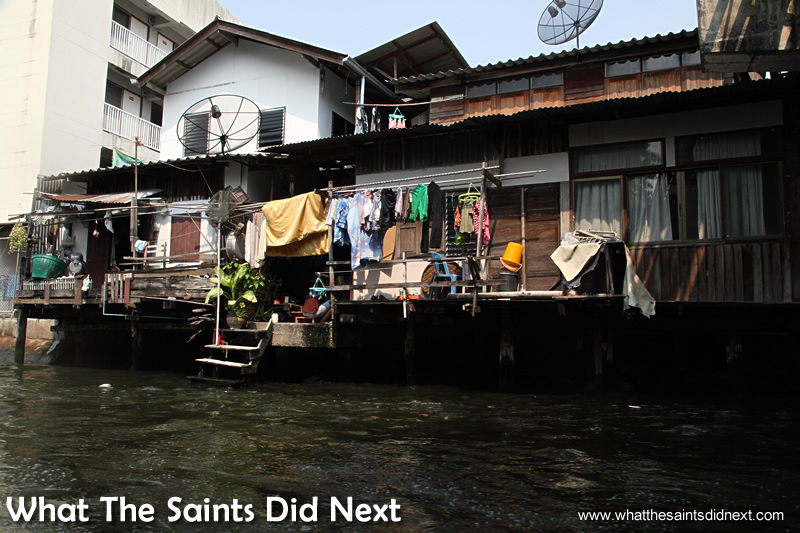 Satellite TV dishes are a constant feature throughout Bangkok, including on the canals.