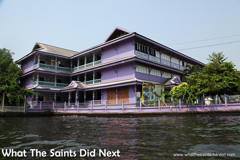 Smart apartment blocks can be found throughout the canal network. Bangkok Long Tail Boat Tour.
