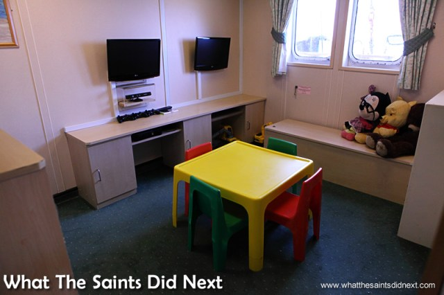 Inside the playroom LCD screens are taking over.  Photographs of the RMS St Helena.