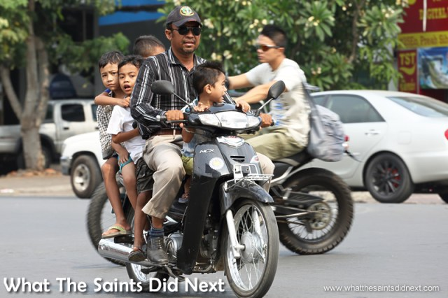 The mighty moped, five people on this one, no problem. Watching Cambodia Traffic.