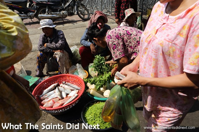 The street market vendors will set up almost anywhere and sell almost anything! Our first time in Phnom Penh exploring the city.