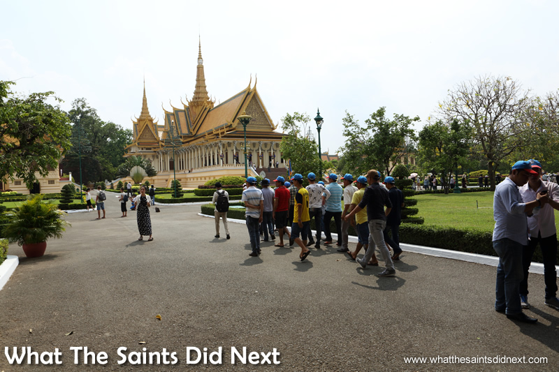 Royal Palace tickets cost US$6.50. Crowds in the gardens heading to The Throne Hall building in the background. Hire a Phnom Penh guide to get a detailed tour.