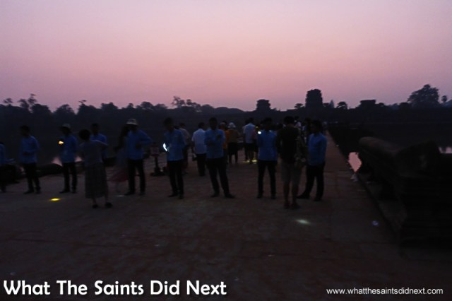 The line of ticket inspectors with torches in the dark, making sure we all have tickets. Watching an Angkor Wat sunrise.