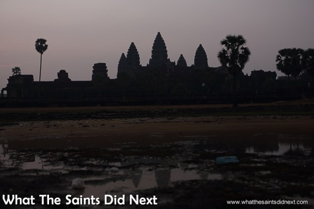 We squeezed through the crowd to snap this shot of how depleted the pond was. Watching an Angkor Wat sunrise.