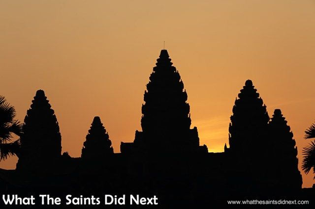 The sky begins to change colour and we know the sun won't be long now.  Watching an Angkor Wat sunrise.