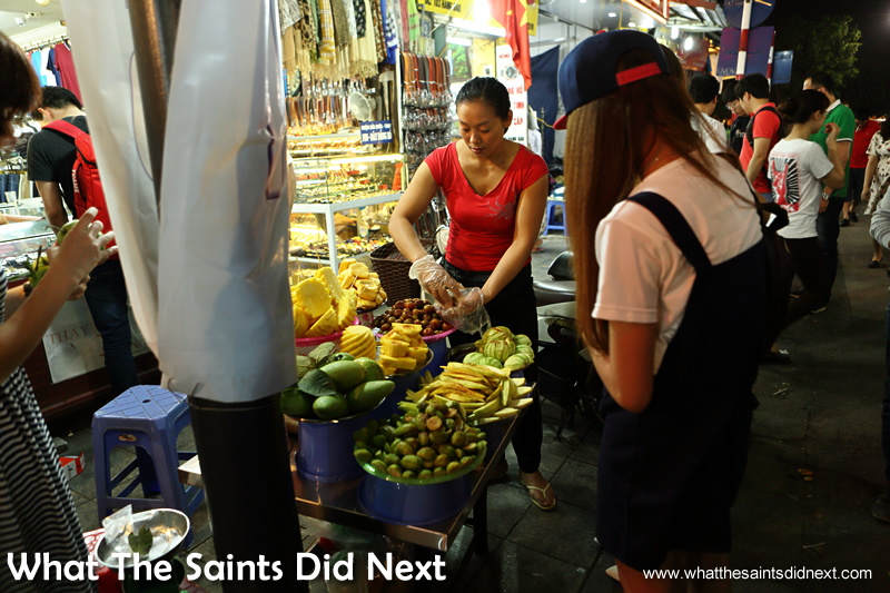 Fresh fruit is available day and night from street vendors in Vietnam.  The Hanoi night market.