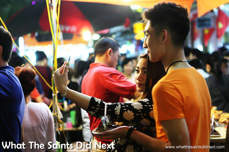 Selfie time is any time. Young people enjoying the night market.