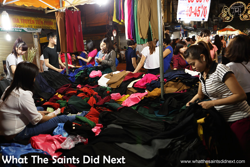 At the Hanoi night market fashion stalls don't seem to be hindered by a lack of changing room!