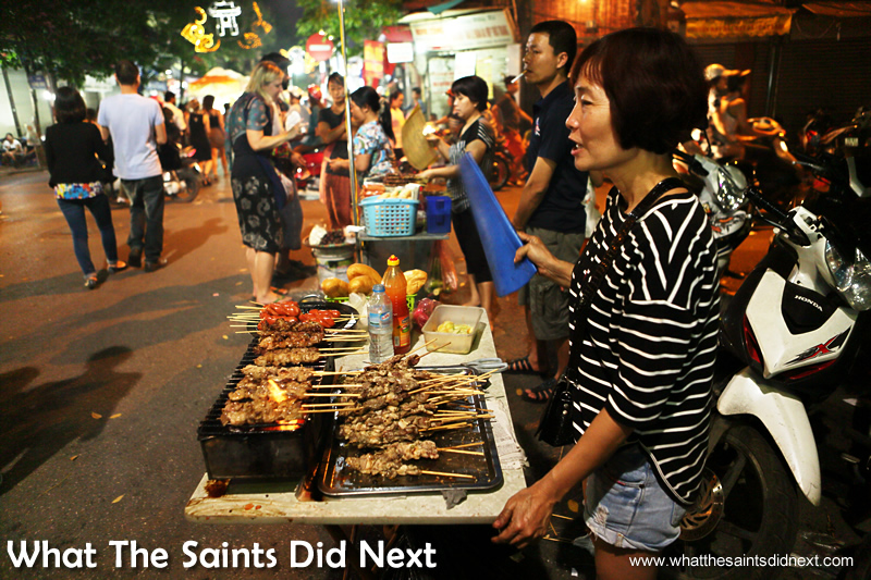 Another food seller at the Hanoi night market with super tasty looking food and the smells to go with it.