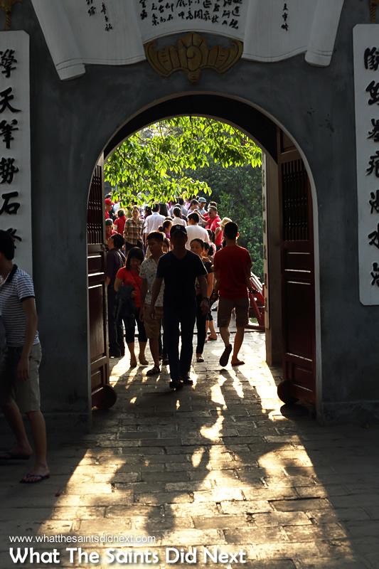 Tourists on The Huc Bridge on Hanoi's Hồ Hoàn Kiếm lake. More than 3 million tourist visited Vietnam from Jan-May 2015.