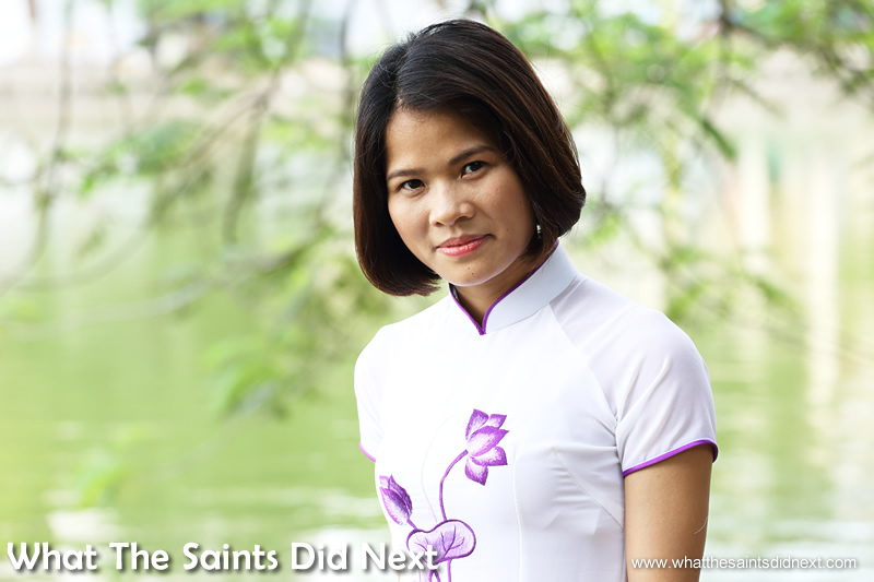 Ao dai Vietnamese traditional dress in purple and white worn by Jane.