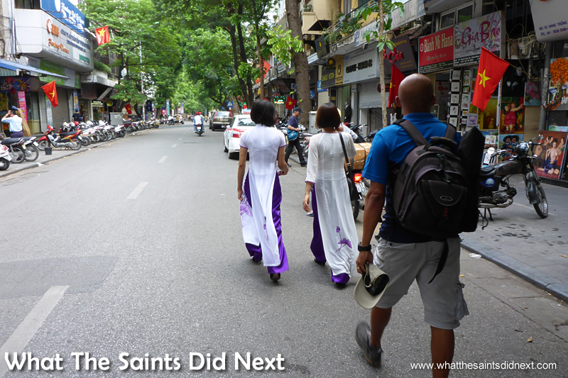 Vietnamese women in ao dai walking through Old Town on the way to the shoot.