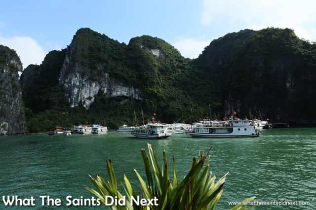 Approaching the limestone island with the Sung Sot Cave.