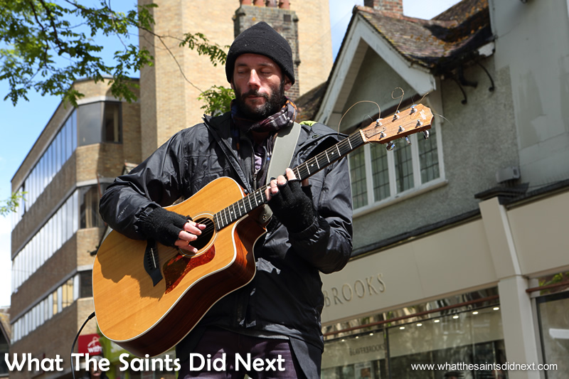 A street entertainer adds to the atmosphere with some great guitar sounds.