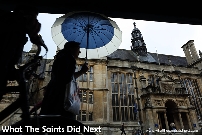 Umbrellas are part of the outfit for a day out in an English town.