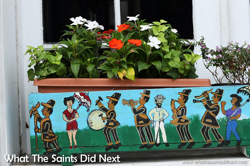 A beautifully decorated flower box in a cafe window.