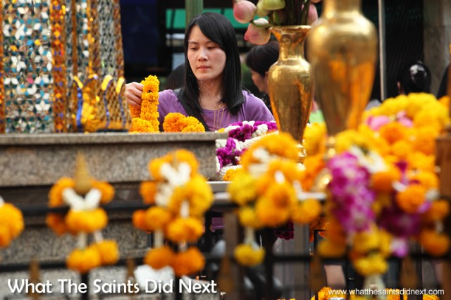 Plenty of colour is brought to the Erawan Shrine by the garlands of orange marigold flowers that are laid around the railings.