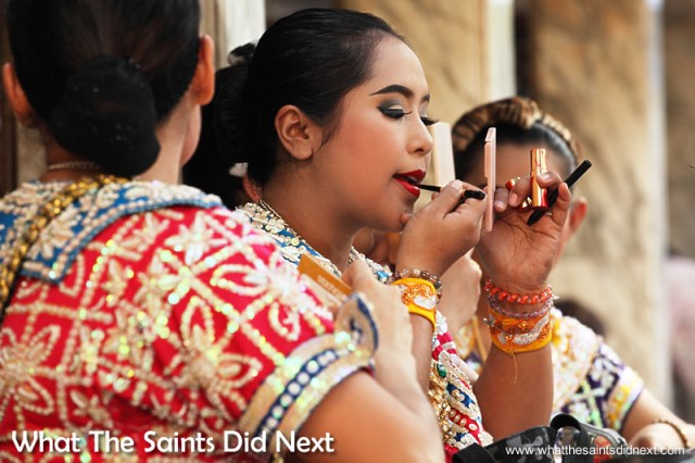 Carefully applying makeup before the routine.