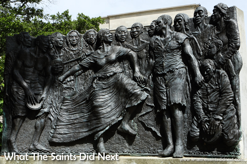 Voodoo origins line in West African Vodun. This Congo Square sculpture depicts slave's 17th century Sunday celebrations. These laid the foundation of NOLA's unique musical traditions including jazz.