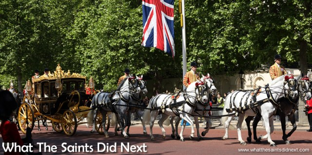 The Queen's carriage pulled by six white horses, travelling up the Mall. Queen Elizabeth II, longest reigning British Monarch.