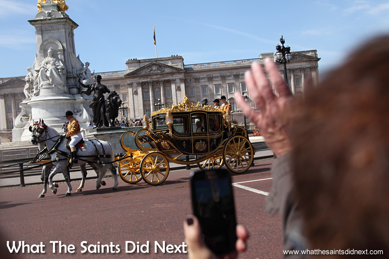 The Queen's carriage leaves Buckingham Palace - trying to get a clean shot amongst the excited crowd.