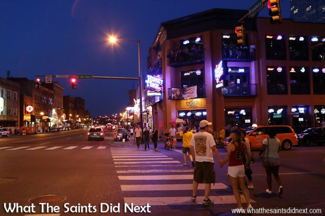 Locals and tourists alike come out to enjoy the night on Broadway in Nashville, Tennessee. The People of Music City Nashville.