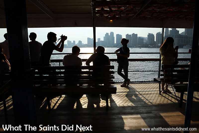 Canon 5D-MKIII: 18:03, 1/320, f/14, ISO-200 Breaking all the rules again with this shot, shooting directly into the late afternoon sunshine on this ferry ride in Toronto, Canada. The long shadows became a feature of this photograph as the students int the foreground were silhouetted against the city skyline.