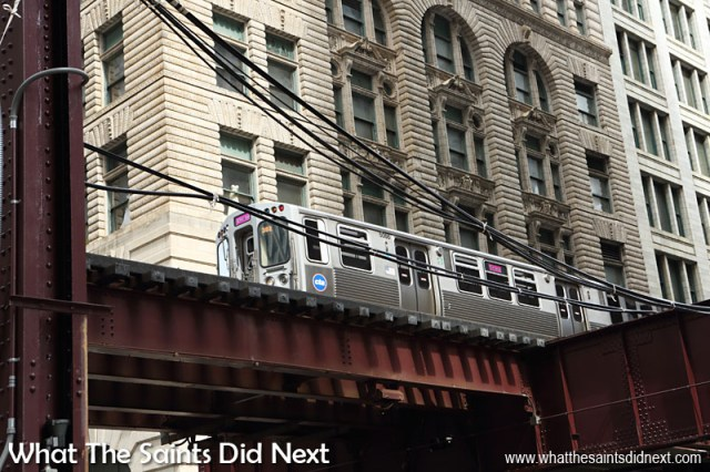 A Loop train passing through downtown Chicago. This elevated railroad system forms the hub of the Chicago 'L' rapid transit system. The Loop circuit itself is 2.88km long; the elevated structure that is in use today was built between 1895-97.