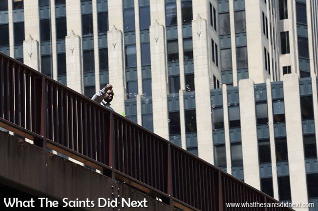 This is the moment we first spotted Andre, up above us on a bridge blowing down bubbles while we walked the banks of the Chicago River. Andre is homeless.