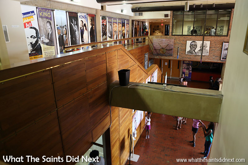 Inside the Grand Foyer of Freedom Hall, part of the Martin Luther King, Jr. Center for Nonviolent Social Change. The paneling lining the staircase is made from the sapeli tree which grows in Nigeria.