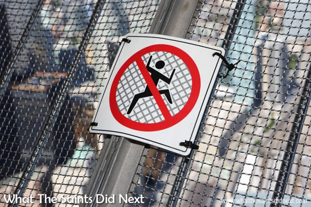 Not a stop sign you see every day! A warning (as if you need it) to not go climbing on the safety mesh around the CN Tower's SkyTerrace.