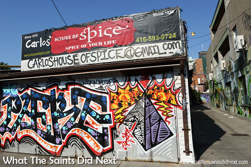Graffiti Street Art of Toronto - An elaborate graffiti tag (name signature) spices up the shutters of this restaurant.