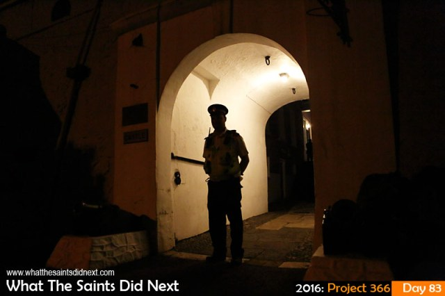 'Counting' 23 March 2016, 19:34 - 1/60, f/2.8, ISO-2000 What The Saints Did Next - 2016 Project 366 A policeman stands guard at the entrance to the Castle, in Jamestown, St Helena, as by election votes are counted inside.