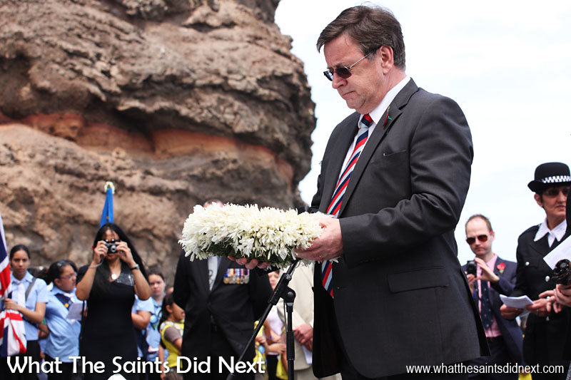 At the annual Remembrance Day Service on St Helena, held each year on the sea front. Governor Mark Capes laying one of the wreaths on the Cenotaph. 11 November, 2012.
