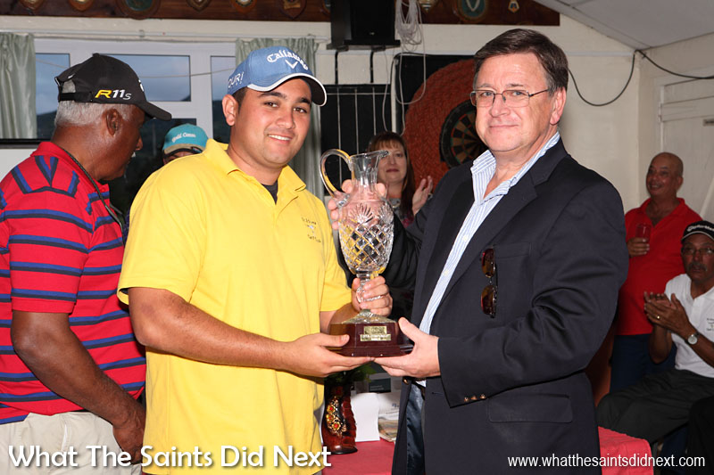 Governor Mark Capes presenting the St Helena Golf Open Champion, Scott Crowie, with the floating trophy in June 2013.  The Governor of St Helena Mark Capes.