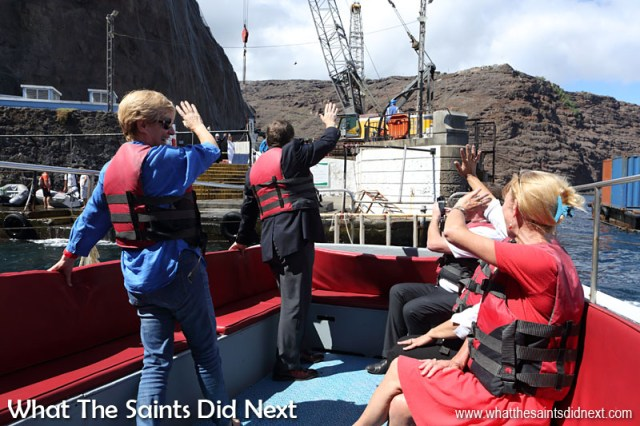 Goodbye St Helena. Governor Mark Capes and Mrs Tamara Capes wave goodbye as the launch pulls away from the wharf steps. 18 March, 2016.  Governor Of St Helena Mark Capes.