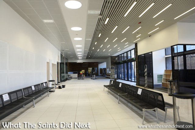 The concourse inside the new St Helena Airport terminal on Prosperous Bay Plain. Note the circular sunlight funnels overhead feeding natural light into the building.