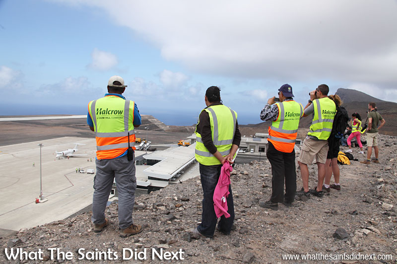 Representatives of the island's media services and airport contractors observing the landing from the top of Mole Spider Hill, overlooking the St Helena Airport.